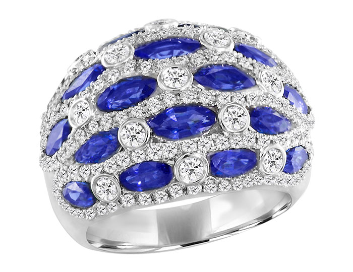 Marquise shape sapphire and round brilliant cut diamond ring in 18k white gold.