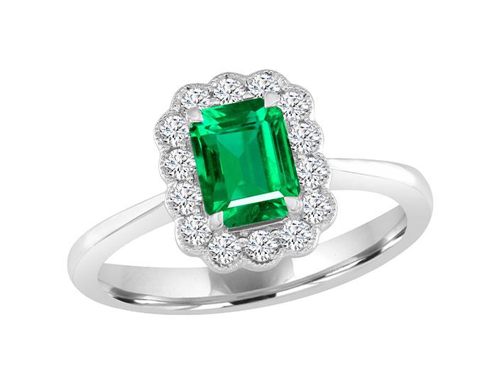 Emerald cut emerald and round brilliant cut diamond ring in 18k white gold.