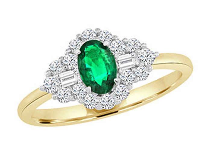 Oval emerald, baguette cut diamond and round brilliant cut diamond ring in 18k yellow and white gold.