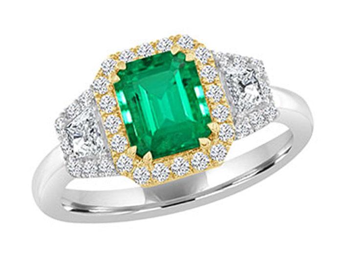 Emerald cut emerald, trapezoid cut diamond and round brilliant cut diamond ring in 18k white and yellow gold.