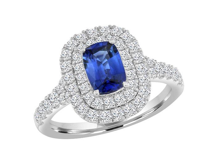 Cushion cut sapphire and round brilliant cut diamond ring in 18k white gold.