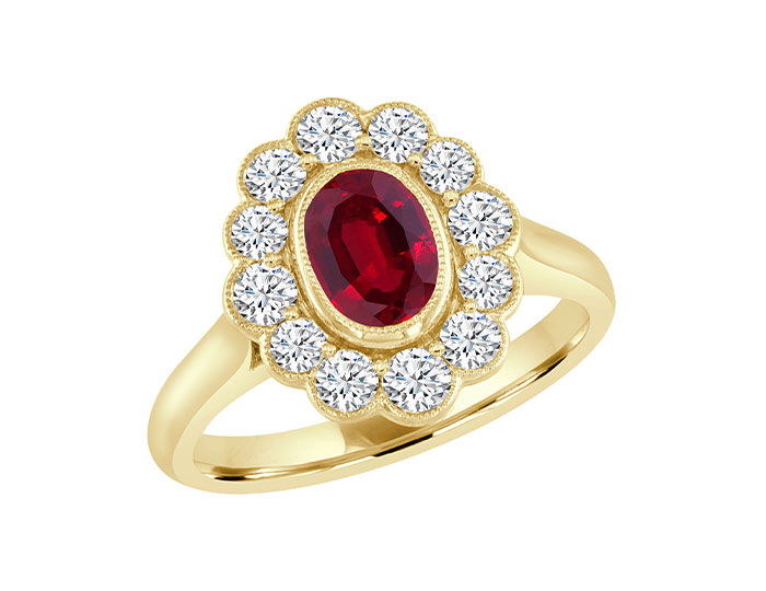 Oval shape ruby and round brilliant cut diamond ring in 18k yellow gold.