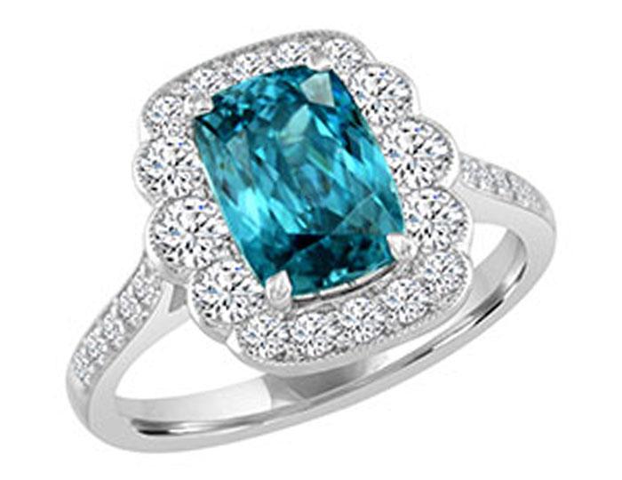 Cushion cut blue zircon and round brilliant cut diamond ring in 18k white gold.