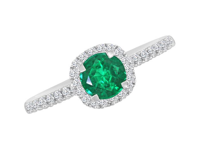 Emerald and round brilliant cut diamond ring in 18k white gold.