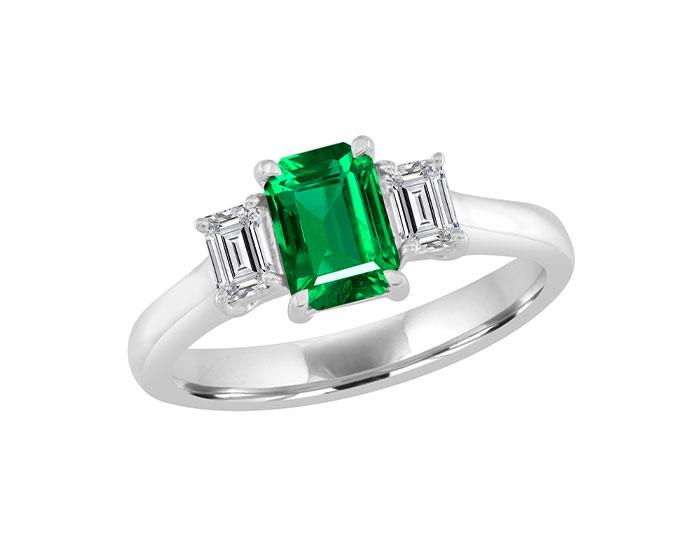 Emerald cut emerald and emerald cut diamond ring in 18k white gold.