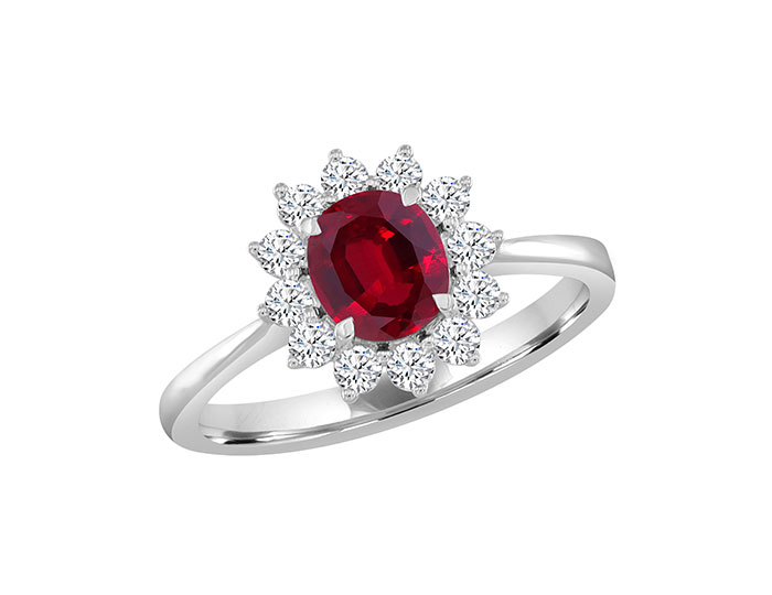 Oval shape ruby and round brilliant cut diamond ring in 18k white gold.