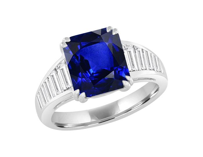 Emerald cut sapphire and bagutte cut diamond ring in 18k white gold.