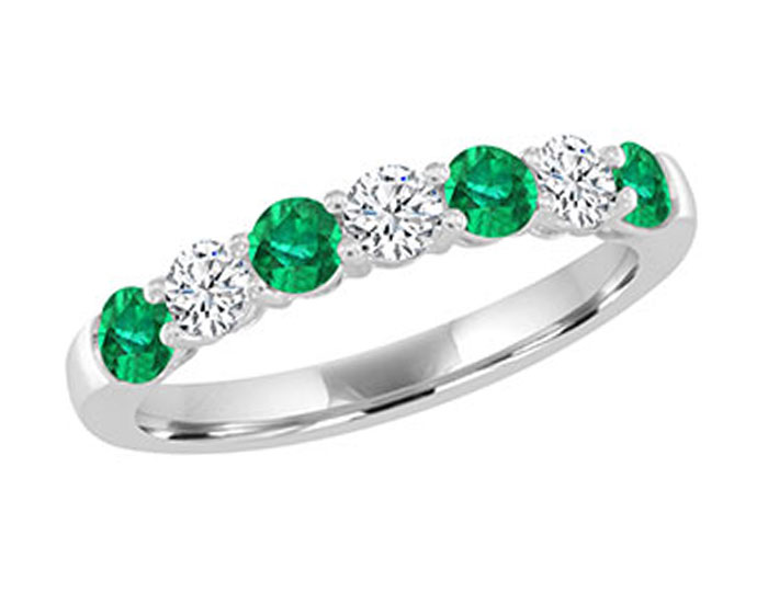 Round shaped emerald and round brilliant cut diamond ring in 18k white gold.