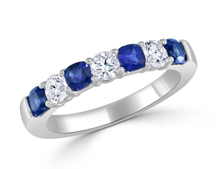 Cushion shape sapphire and round brilliant cut diamond band in 18k white gold.