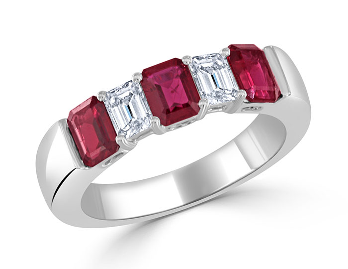 Emerald cut ruby and diamond band in 18k white gold.