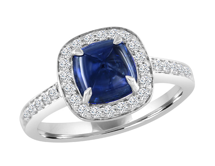 Cushion shape sapphire cabochon and round brilliant cut diamond ring in 18k white gold.