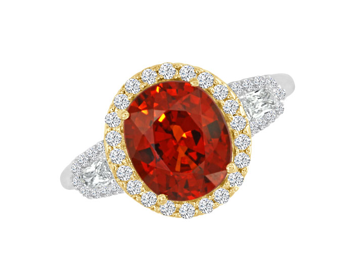 Oval mandarin garnet, shield cut diamond and round brilliant cut diamond ring in 18k white and yellow gold.