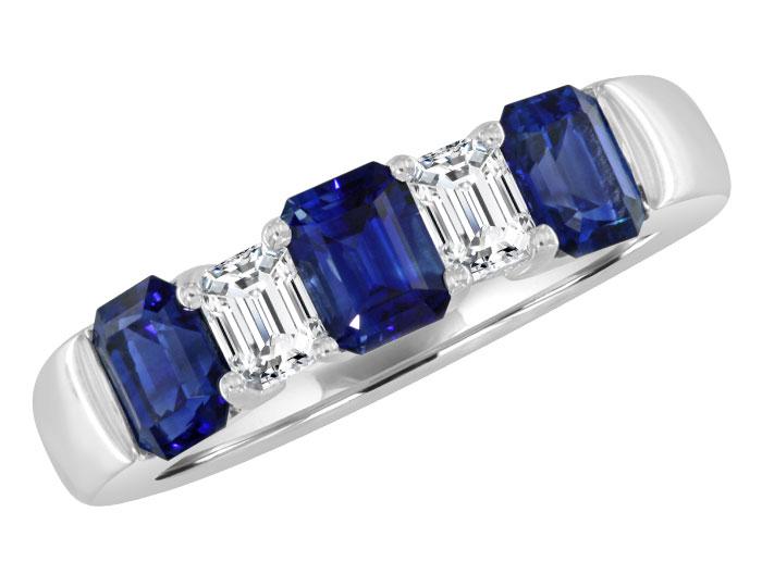 Emerald cut sapphire and emerald cut diamond ring in 18k white gold.