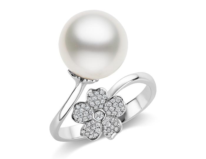 Mikimoto round brilliant cut diamond and white south sea pearl ring in 18k white gold.