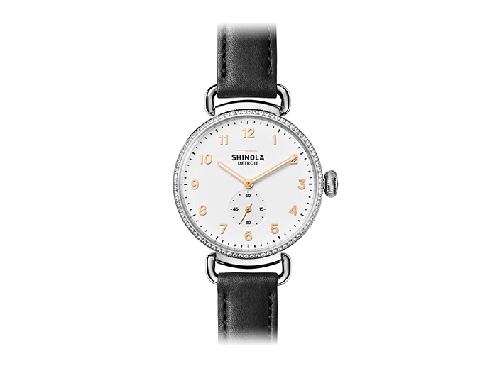 Shinola Canfield 38mm stainless steel leather strap watch with a diamond bezel.