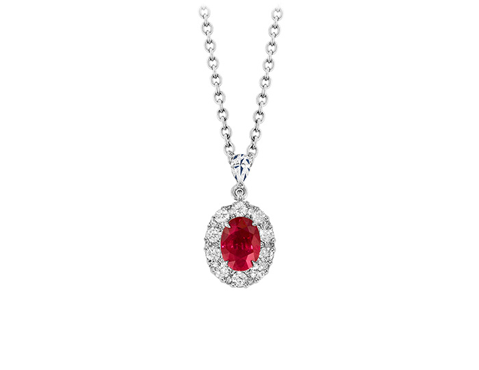 Ruby pendant with round brilliant cut diamonds in 18k white gold.