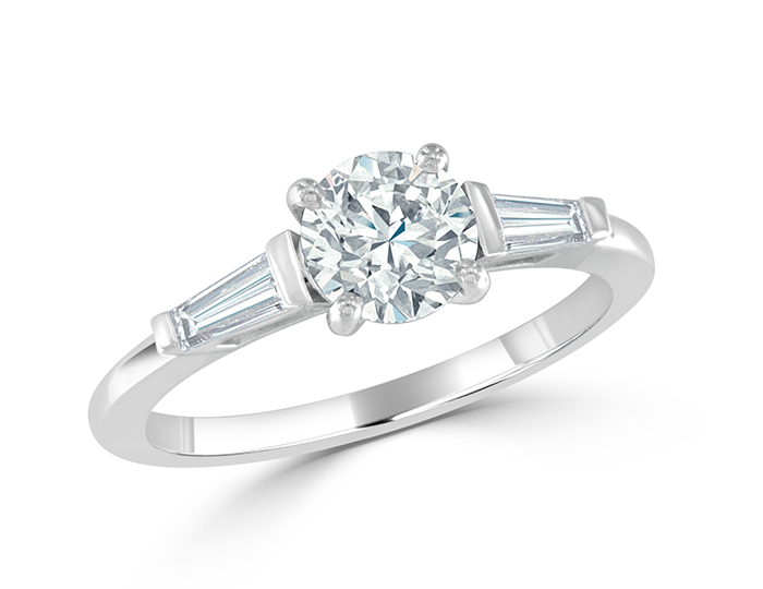 Round brilliant cut and tapered baguette diamond engagment ring in platinum.