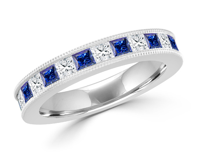 Princess cut sapphire and princess cut diamond band in 18k white gold.