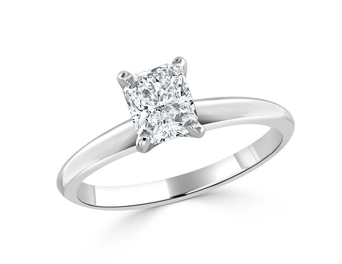 Radiant cut diamond solitaire engagement ring in platinum.