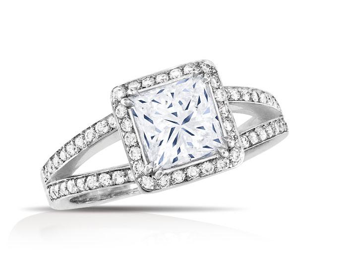 Princess cut and round brilliant cut diamond engagement ring in platinum.