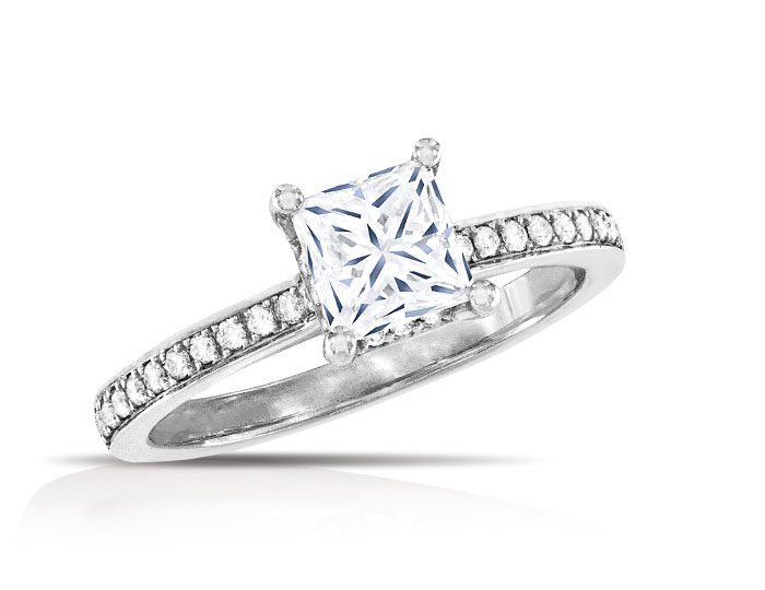 Princess cut center diamond and round brilliant cut diamond engagement ring in 18k white gold.