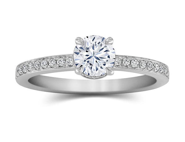 Bez Ambar round brilliant cut diamond engagement ring in platinum.