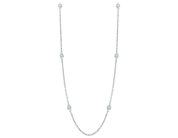 Round brilliant cut diamond bezel necklace in 18k white gold.