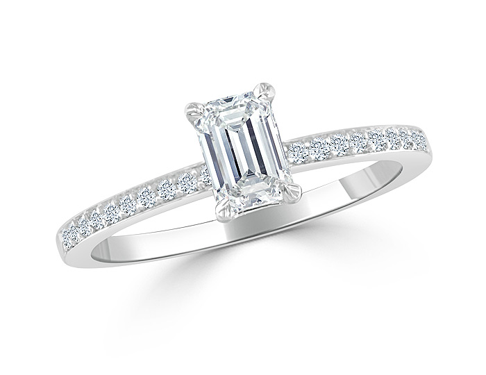Bez Ambar emerald cut and round brilliant cut diamond engagement ring in 18k white gold.