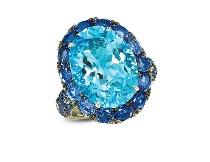 Blue topaz and sapphire and round brilliant cut diamond ring in 18k white gold.