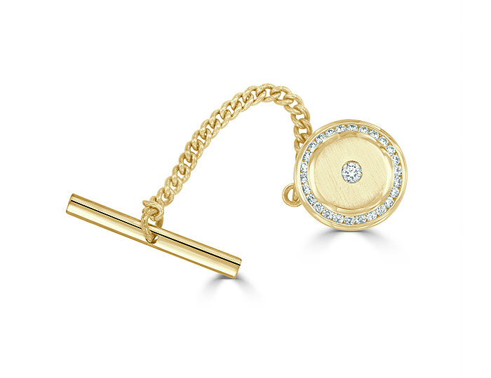 Round brilliant cut diamond tie-tac in 14k yellow gold.