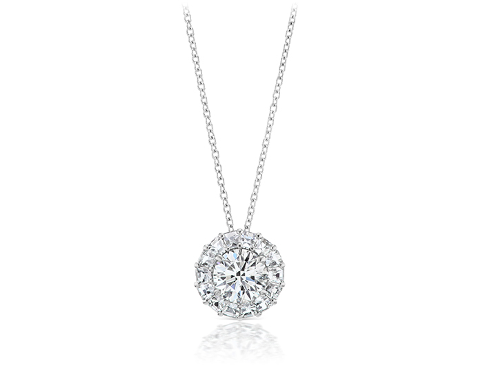 Round brilliant cut and blaze cut diamond pendant in 18k white gold.