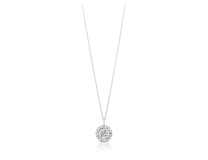 Round brilliant cut and blaze cut diamond necklace in 18k white gold.