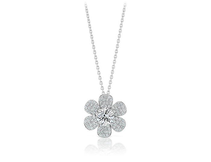 Round brilliant cut diamond pendant in 18k white gold.