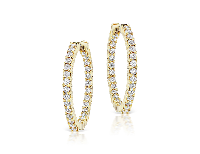Roberto coin collection round brilliant cut diamond hoops in 18k yellow gold.