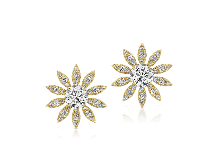 Round brilliant cut diamond earrings in 18k white gold.