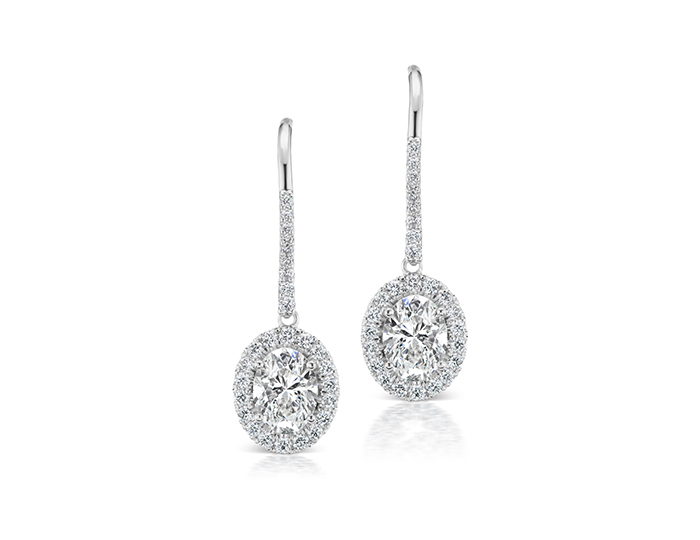 Oval and round brilliant cut diamond earrings in 18k white gold.