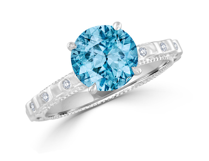 Round aquamarine and round brilliant cut diamond ring in 18k white gold.