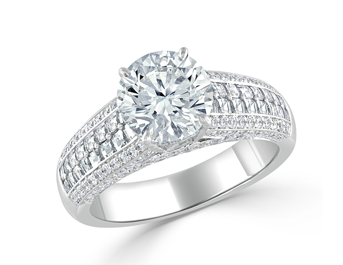 Round brilliant cut and blaze cut diamond engagement ring in 18k white gold.