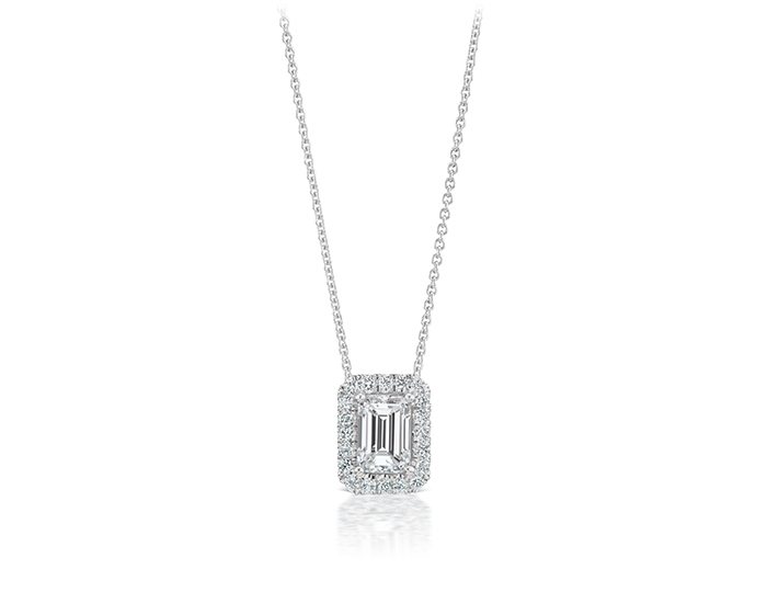 emerald cut and round brilliant cut diamond pendant in 18k white gold.