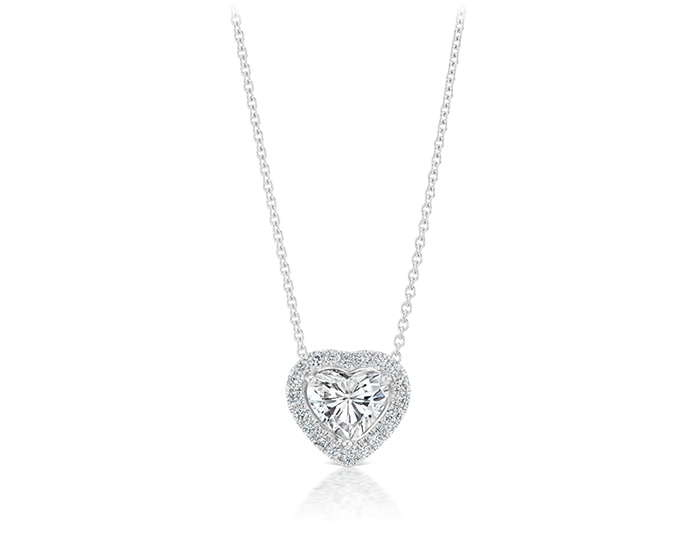 Heart shape and round brilliant cut diamond pendant in 18k white gold.