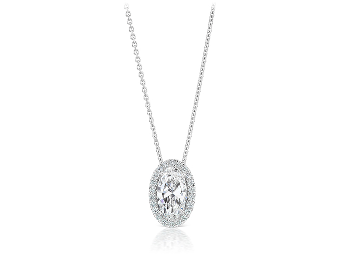 Oval cut and round brilliant cut diamond pendant in 18k white gold.