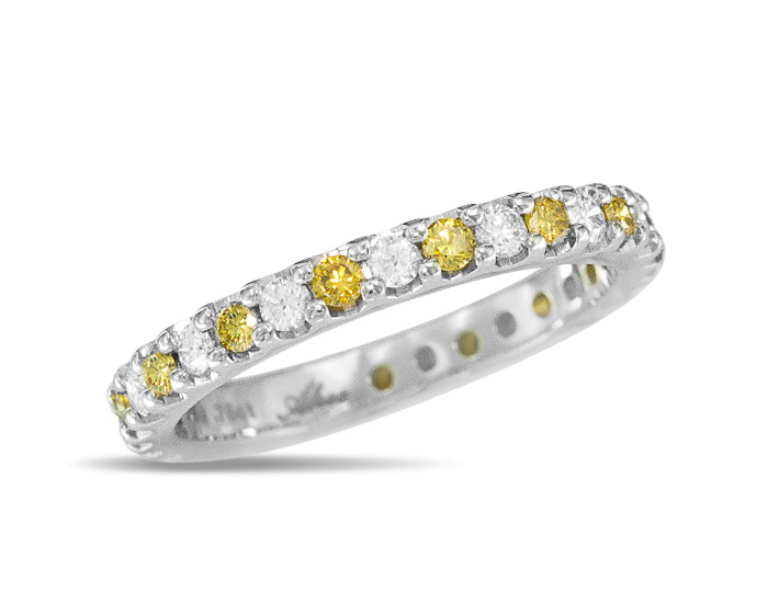 Round brilliant cut yellow and white diamond band in platinum.