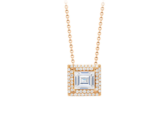 Emerald cut center diamond with round brilliant cut diamond pendant in 18k rose gold.