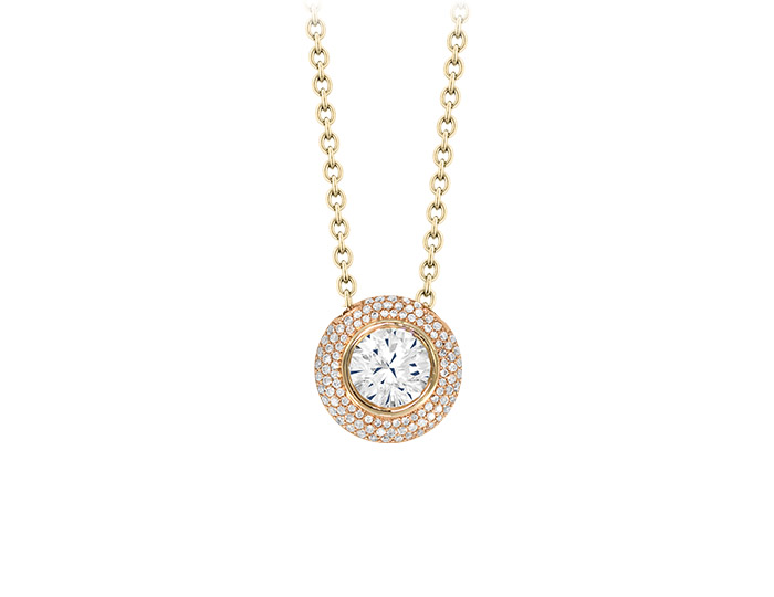 Round brilliant cut diamond pendant in 18k rose gold.
