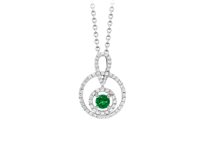 Emerald and round brilliant cut diamond pendant in 18k white gold.