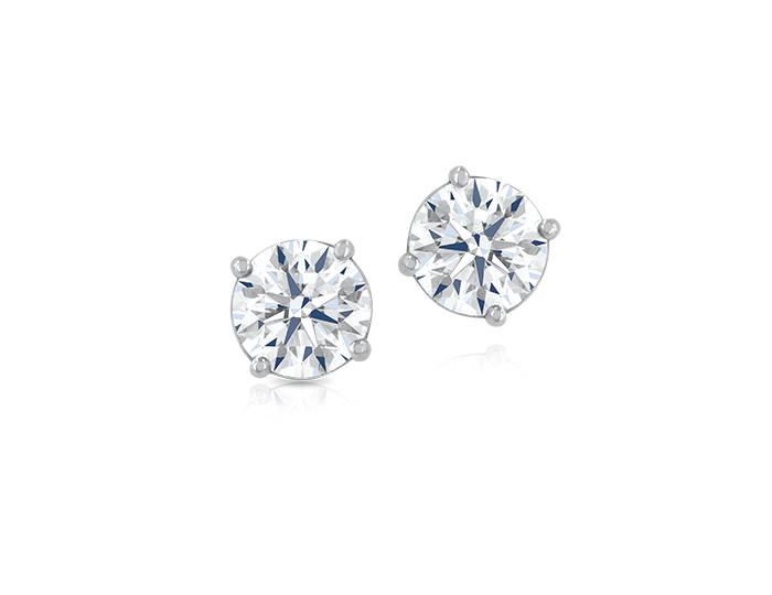 Round brilliant cut diamond stud earrings in platinum.