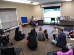 Librarian reading stories to parents and toddlers