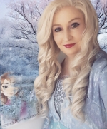Queen Elsa in costume in a snowscape with a drawing of Anna behind her