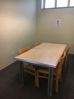 An image of a study room with four chairs.