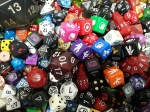 a pile of various sided dice